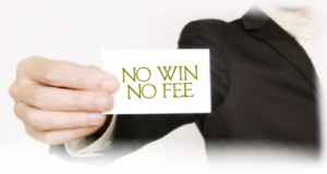 Man in suit holding card which says No Win No Fee Lawyers