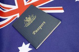 Australian passport on top of Australian flag