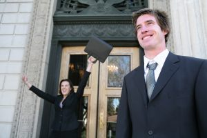 Lawyers celebrating success outside of Court
