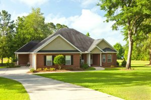 Brick house in country garden setting