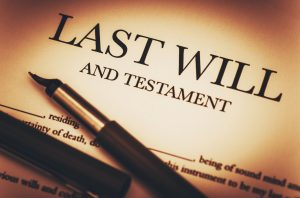 Fountain pen on top of Last Will and Testament
