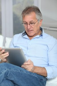 Older man looking at retirement village contract